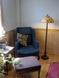 A comfy reading corner in the front parlor. The dining room table (not shown) is to the right.